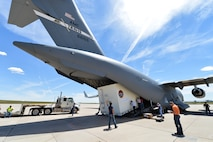 The Mars Atmosphere and Volatile Evolution Mission spacecraft is carefully loaded in the back of a C-17 Globemaster III Aug. 2, 2013, at Buckley Air Force Base, Colo. After the MAVEN launches in late 2013, it will orbit around the sun for a 10-month mission before heading to Mars. (U.S. Air Force photo by Staff Sgt. Paul Labbe/Released)