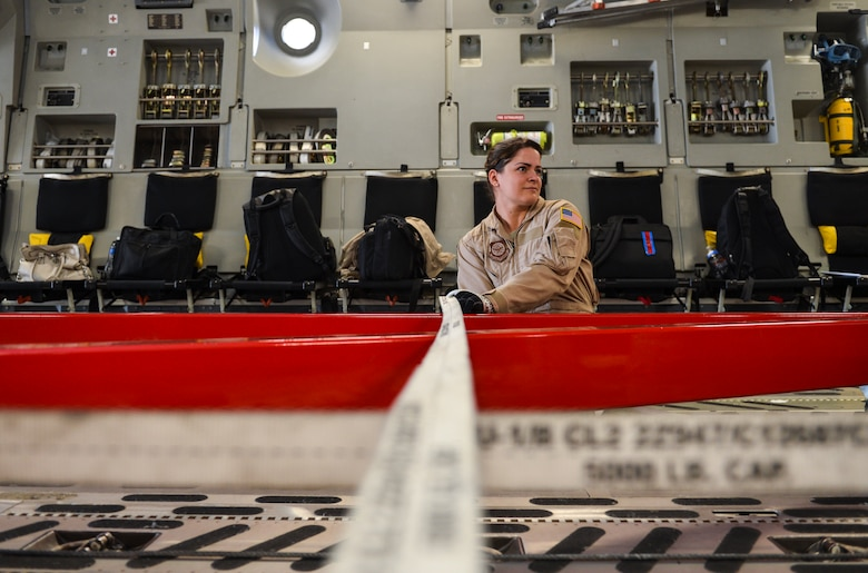 Senior Airman Desiree Lemus, 21st Airlift Squadron loadmaster and native of Homestead, Fla., ratchets cargo equipment into place inside a C-17 Globemaster III Aug. 2, 2013, at Buckley Air Force Base, Colo. The crewmembers aboard the C-17, which includes four pilots, two loadmasters and one crew chief, flew the spacecraft to its final destination at the Kennedy Space Center. (U.S. Air Force photo by Staff Sgt. Paul Labbe/Released)