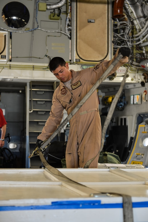 Tech. Sgt. Patrick Bloom, 21st Airlift Squadron loadmaster and native of Highlands Ranch, Colo., secures a part of the Mars Atmosphere and Volatile Evolution Mission spacecraft Aug. 2, 2013, at Buckley Air Force Base, Colo. The MAVEN spacecraft is built out of aluminum and graphite and weighs 275 pounds. (U.S. Air Force photo by Staff Sgt. Paul Labbe/Released)