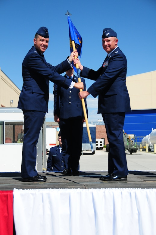 "Col. Peter L. ""Pete"" Linde, right, accepts command of the 153rd Maintenance Group from Col. Michael R. Taheri, 153rd Airlift Wing commander, during a ceremony Aug. 4, 2013 at the Wyoming Air National Guard Base, Cheyenne, Wyo. The passing of the guidon is a symbolic gesture in front of an entire unit to witness a new leader assume their dutiful position. (U.S. Air National Guard photo by Capt. Rusty Ridley)"