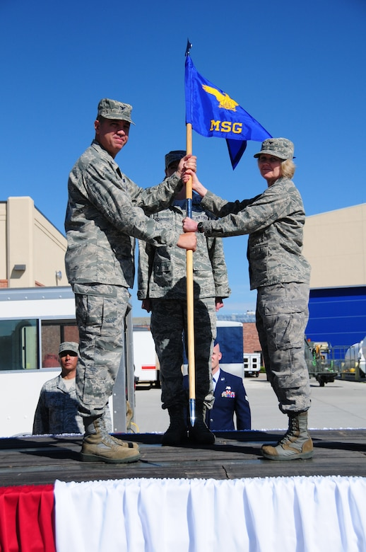 Col. Shelley R. Campbell, right, accepts command of the 153rd Mission Support Group from Col. Michael R. Taheri, 153rd Airlift Wing commander, during a ceremony Aug. 4, 2013 at the Wyoming Air National Guard Base, Cheyenne, Wyo. The passing of the guidon is a symbolic gesture in front of an entire unit to witness a new leader assume their dutiful position. (U.S. Air National Guard photo by Capt. Rusty Ridley)