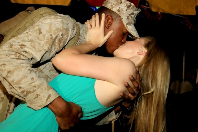 Cpl. Joshua Carnegie, tank gunner, Company D, 1st Tank Battalion, embraces his girlfriend, Lauren Griffith, at the battalion's homecoming ceremony held aboard the Combat Center July 28. The company returned from their deployment to Afghanistan in support of Opperation Enduring Freedom.