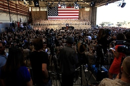 Service members and their families listen as Commander in Chief, Barak Obama, addresses them at the Marine Corps Air Station Camp Pendle