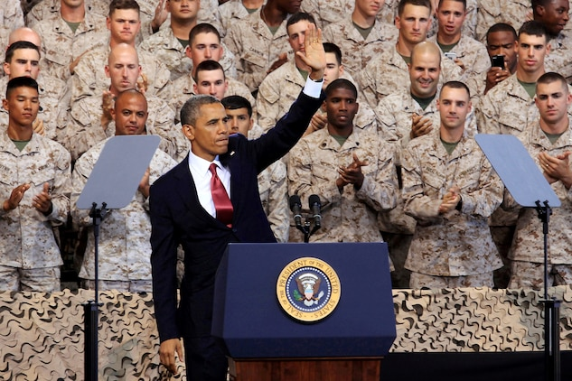 Commander in Chief, Barack Obama, waves to service members and their families after addressing them at the Marine Corps Air Station Camp Pendleton Aug.7. Obama spoke about the importance of the Marine Corps maintaining their amphibious roots as they withdraw from the war in Afghanistan.