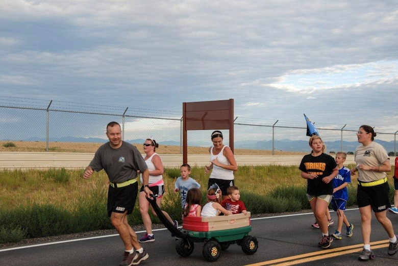 Col. Anthony Hale, 704th Military Intelligence Brigade commander, joins the families of the 743rd Military Intelligence Battalion, 704th MI Bde., during the battalion run July 15, 2013, at Buckley Air Force Base, Colo. (Courtesy Photo)