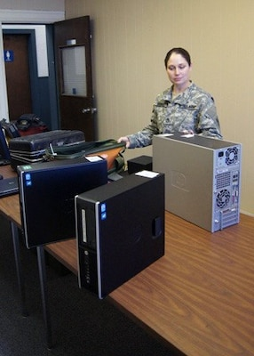 Staff Sgt. Katie Herrell sorts through computer equipment recently. Herrell is the readiness sergeant for the Missouri National Guard Computer Network Defense Team, a newly formed cyber security unit setting up shop at the historic military post in south St. Louis County.