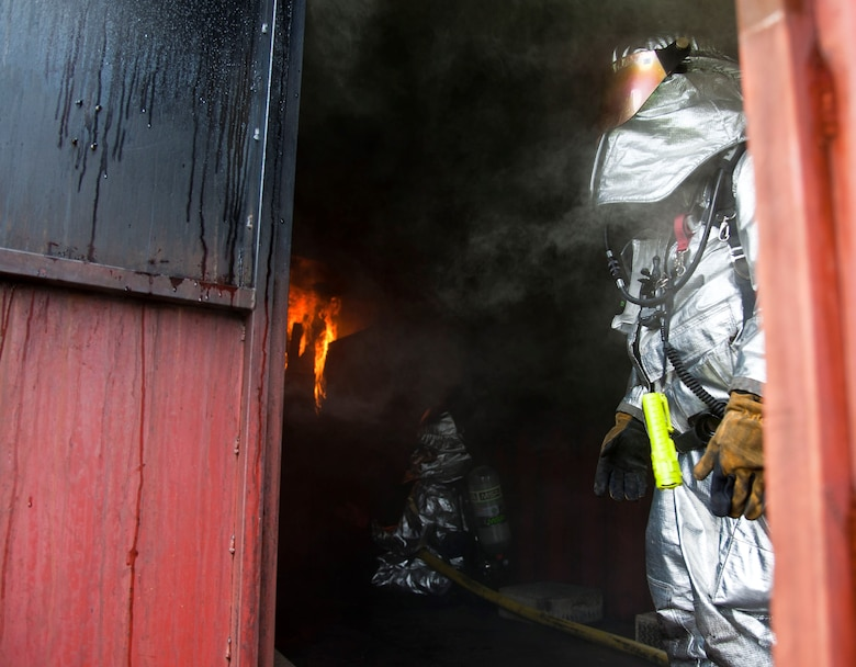 A fire burns bright inside the flashover simulator July 30, 2013, at Yokota Air Base, Japan. Marine Corps Air Station Iwakuni firefighters visited Yokota AB for joint training on recognizing and safely evading flashovers. (U.S. Air Force photo/Airman 1st Class Soo C. Kim)