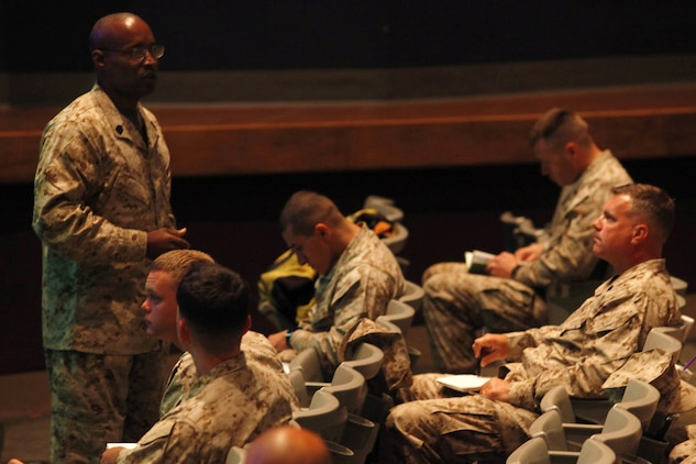 Sgt. Maj. Mark A. Byrd briefs more than 45 Marines during the Manpower Management Support Branch Promotion and Performance brief at the base theater here Aug. 7. The brief covered information to assist Reporting Seniors and Reviewing Officers with completing fitness reports, as well as help Marines receiving reports better understand how they are evaluated. Byrd is the sergeant major for the Performance Evaluation Section at Headquarter Marine Corps.