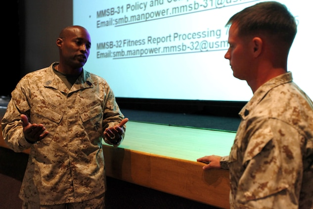 Sgt. Maj. Mark A. Byrd answers a question asked by Sgt. Jasper Sicz after the Manpower Management Support Branch Promotion and Performance brief at the base theater here Aug. 7. The brief covered information to assist Reporting Seniors and Reviewing Officers with completing fitness reports, as well as help Marines receiving reports better understand how they are evaluated. Byrd is the sergeant major for the Performance Evaluation Section at Headquarter Marine Corps. Sicz is a maintenance management chief with 1st Combat Engineer Battalion, 1st Marine Division.
