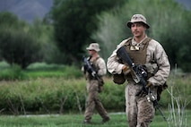 U.S. Marine Lance Cpl James Haviland with 3rd Battalion, 3rd Marine Regiment, III Marine Expeditionary Force, patrols during a portion of the river reconnaissance lane training at Exercise Khaan Quest in Five Hills Training Area, Mongolia, August 6, 2013. Khaan Quest is an annual multinational exercise sponsored by the U.S. and Mongolia, and it is designed to strengthen the capabilities of U.S., Mongolian and other nations' forces in international peace support operations.(U.S. Marine Corps Photo by Sgt John M. Ewald/released)