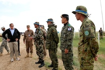 Dr. Peter R. Lavoy, Acting Assistant Secretary of Defense for Asian and Pacific Security Affairs, meets with vehicle checkpoint lane instructors from Nepal, German, Republic of Korea and Japan, during a visit to Five Hills Training Area, Aug.6. Approximately 1,000 service members from 13 different nations are participating in the exercise. The command post exercise (CPX) and field training exercise (FTX) take place at Five Hills Training Area in Mongolia, both focusing on peacekeeping and stability operations. Dr. Lavoy toured the area to meet with exercise participants and leadership from Mongolia, U.S. and other participating nations. U.S. Marine Corps Forces Pacific is the executive agent for Khaan Quest 2013.