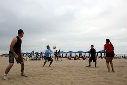 Col. Michael E. Cordero bumps the volleyball during the Commanding Generals Cup, Four Person Beach Volleyball Tournament held at Del Mar Beach Resort here August 7.  Cordero is the commanding officer of Headquarters and Support Battalion here. The tournament is an annual event and had over 120 Marines and sailors in attendance.