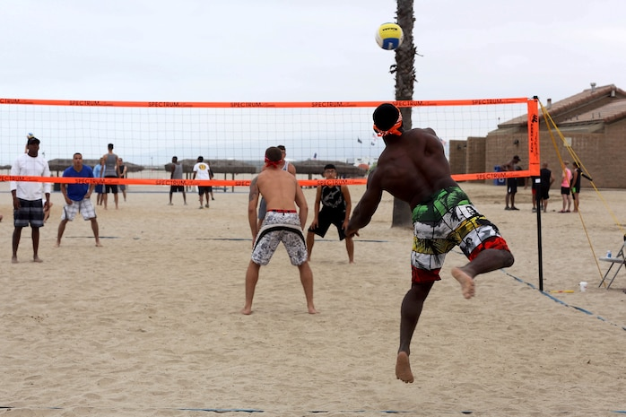 Cpl. Malcolm Jackson serves the ball during his team's first game of the Commanding Generals Cup, Four Person Beach Volleyball Tournament held at Del Mar Beach Resort here August 7. Jackson is an intelligence analyst for 1st Intelligence Battalion here and plays on the Secret Squirrels team that took third place overall in the tournament. The tournament is an annual event and had over 120 Marines and sailors in attendance.