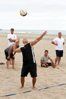 Sgt. Brian Riddle serves the ball during of the Commanding Generals Cup, Four Person Beach Volleyball Tournament held at Del Mar Beach Resort here August 7. Riddle is a Marine with Wounded Warriors Battalion-West here. The tournament is an annual event and had over 120 Marines and sailors in attendance.