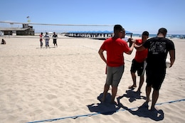 Team USO and the Islanders collaborate during a time out in the final game for the championship title at the Commanding Generals Cup, Four Person Beach Volleyball Tournament held at Del Mar Beach Resort here August 7. The Marines in Team USO are from 1st Light Armored Reconnaissance Battalion here. The Islanders are sailors from the naval hospital here. The tournament is an annual event and had over 120 Marines and sailors in attendance.