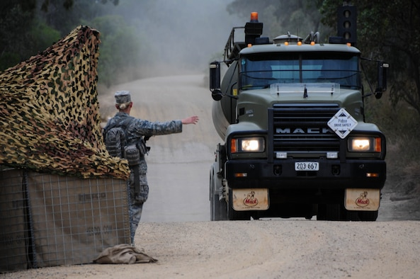 Senior Airman Hannah Phillips, 736th Security Forces Squadron response force leader, halts a vehicle at an entry control point July 22, 2013, at Royal Australian Air Force Williamson Airfield, Australia during Talisman Saber. The 36th Contingency Response Group, from Andersen Air Force Base, Guam, participated in the two-week exercise where their mission included initial air base opening operations after a simulated seizure of an airfield from enemy forces to support the surge of more coalition forces.  (U.S. Air Force photo by Airman 1st Class Marianique Santos/Released)