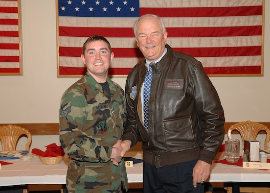 Then Senior Airman R.J. Biermann, 9th Reconnaissance Wing Public Affairs staff writer, shakes hands with former Secretary of the Air Force, Michael Wynne in the fall of 2007. Biermann gained 30 pounds from 2007 to 2008. (Courtesy photo)