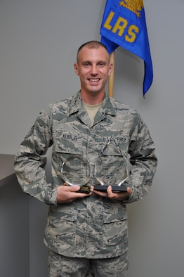 Technical Sgt. Roger Kubilis proudly displays the two plaques he recently received from the Non Commissioned Officer Academy in-residence course at Peterson AFB, Colo.  on July 17.  Kubilis was awarded the Academic Achievement Award and the Distinguished Graduate Award, beating out 125 other active duty, Guard and Reserve members in the class.  (U.S. Air Force photo/Senior Airman Mark Hybers)