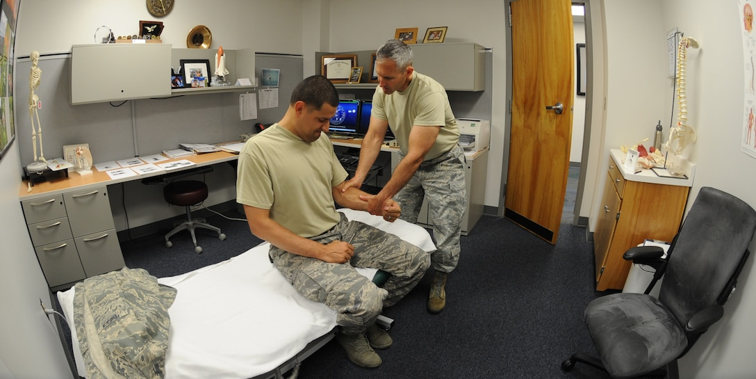 U.S. Air Force Maj. Michael Holmes, 509th Medical Operations Squadron physical therapy technician, conducts a strength exercise during an initial evaluation with U.S. Air Force Staff Sgt. Tim Ferguson, 509th Maintenance Group command chief assistant, at Whiteman Air Force Base, Mo., Aug. 6, 2013. The physical therapy clinic devises a program plan unique to each individual and his or her injuries. (U.S. Air Force photo by Airman 1st Class Bryan Crane/Released)