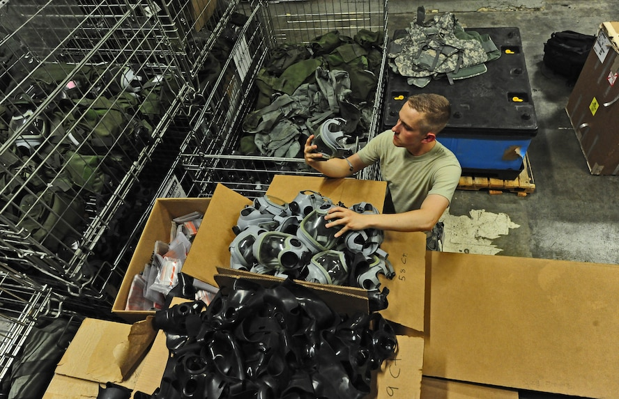 U.S. Air Force Airman 1st Class David Reddoch, 509th Logistics Readiness Squadron individual protective equipment technician, inspects a gas mask as part of a routine assessment at Whiteman Air Force Base, Mo., July 29, 2013. Part of Reddoch's assessment includes disassembling the masks and ensuring they are sanitized to guarantee that customers are given clean equipment. (U.S. Air Force photo by Staff Sgt. Nick Wilson/Released)