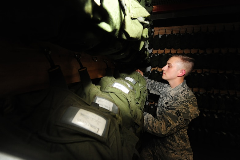 U.S. Air Force Airman 1st Class David Reddoch, 509th Logistics Readiness Squadron individual protective equipment technician, verifies inspection dates on gas masks as part of a routine assessment at Whiteman Air Force Base, Mo., July 29, 2013. Along with providing serviceable gas masks, IPE technicians have a mission to ensure the base populace is outfitted with serviceable life-saving equipment for training and deployments. (U.S. Air Force photo by Staff Sgt. Nick Wilson/Released)