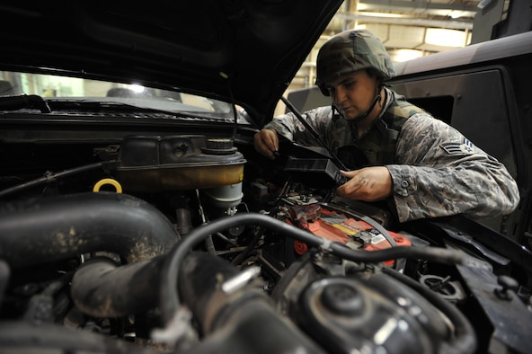 Senior Airman Michael Geer, 51st Logistics Readiness Squadron vehicle maintenance technician, inspects a vehicle