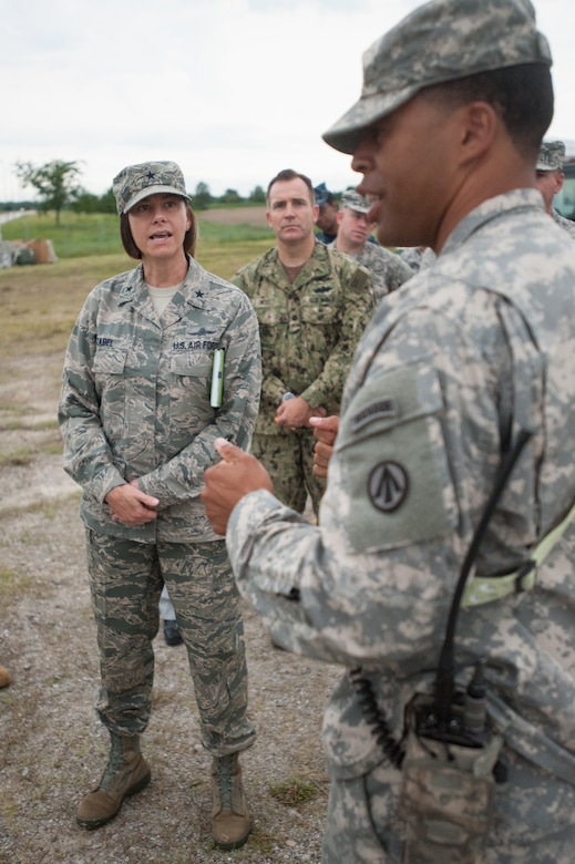 Army Capt. Charles Greene, commander of the U.S. Army's 689th Rapid Port Opening Element, discusses cargo movement operations with Brig. Gen. Sarah Zabel, director of command, control, communications and Ccyber systems at U.S. Transportation Command, during Exercise Gateway Relief at MidAmerica St. Louis Airport in Mascoutah, Ill., on Aug. 7, 2013.  The exercise is designed to test the ability of the 689th and the Kentucky Air National Guard's 123rd Contingency Response Group ability to stand up and operate a Joint Task Force-Port Opening, which receives relief supplies by airlift and stages them for movement over land. (U.S. Air National Guard photo by Maj. Dale Greer)