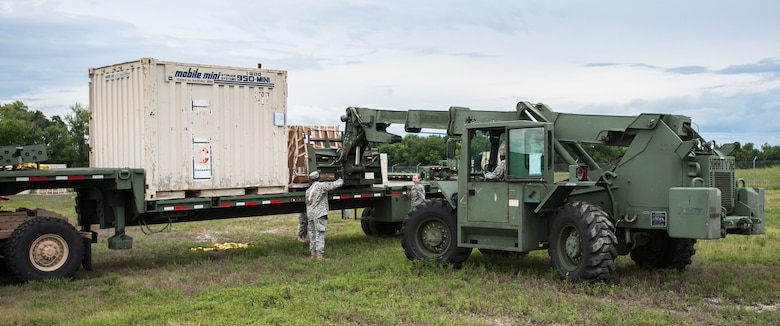 Army Spc. Brandon Glaspie and Army Pfc. Loura Wiggs of the U.S. 689th Army's Rapid Port Opening Element in Fort Eustis, Va., direct the placement of a pallet of disaster-relief supplies onto a flat-bed truck at MidAmerica St. Louis Airport in Mascoutah, Ill., on Aug. 7, 2013, as part of Exercise Gateway Relief, a U.S. Transportation Command-directed earthquake-response scenario. The Soldiers were working at the forward node of a Joint Task Force-Port Opening, where relief supplies that arrive by air are staged for further movement over land by trucks. The Kentucky Air National Guard's 123rd Contingency Response Group operated the airlift side of the JTF-PO, known as an Aerial Port of Debarkation. (U.S. Air National Guard photo by Maj. Dale Greer)