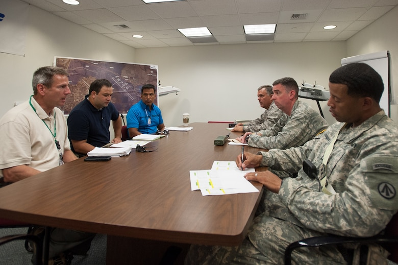 Col. Mark Heiniger, commander of the Kentucky Air National Guard's 123rd Contingency Response Group, Lt. Col. Bruce Bancroft, director of the Joint Operations Center for Exercise Gateway Relief, and Capt. Charles Greene, commander of the U.S. Army's 689th Rapid Port Opening Element in Fort Eustis, Va., brief notional representatives from the Federal Emergency Management Agency at MidAmerica St. Louis Airport in Mascoutah, Ill., on Aug. 7, 2013, as part of a U.S. Transportation Command-directed earthquake-relief scenario. The 123rd is teaming up with the 689th through Aug. 9 to operate a Joint Task Force-Port Opening, which combines an Air Force Aerial Port of Debarkation with an Army trucking and distribution unit. (U.S. Air National Guard photo by Maj. Dale Greer)