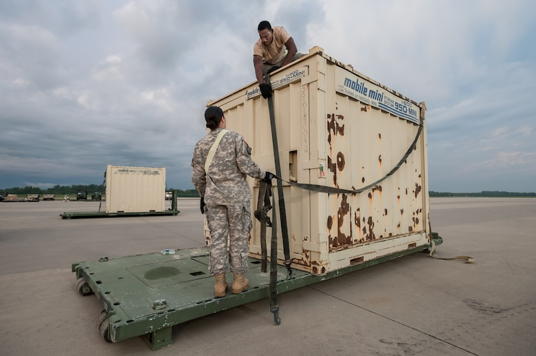Army Sgt. Brenda Acuna and Army Spc. Marquis Talbot of the U.S. Army's 689th Rapid Port Opening Element in Fort Eustis, Va., strap simulated disaster-relief supplies to a flat-rack pallet on the flight line of MidAmerica St. Louis Airport in Mascoutah, Ill., on Aug. 7, 2013, as part of Exercise Gateway Relief, a U.S. Transportation Command-directed earthquake-response scenario. The 689th is joining with the Kentucky Air National Guard's 123rd Contingency Response Group to stand up and operate a Joint Task Force-Port Opening through Aug. 9. The JTF-PO, which combines an Air Force Aerial Port of Debarkation with an Army trucking and distribution unit, ensures the smooth flow of relief supplies into affected areas by airlift and coordinates final distribution over land. (U.S. Air National Guard photo by Maj. Dale Greer)