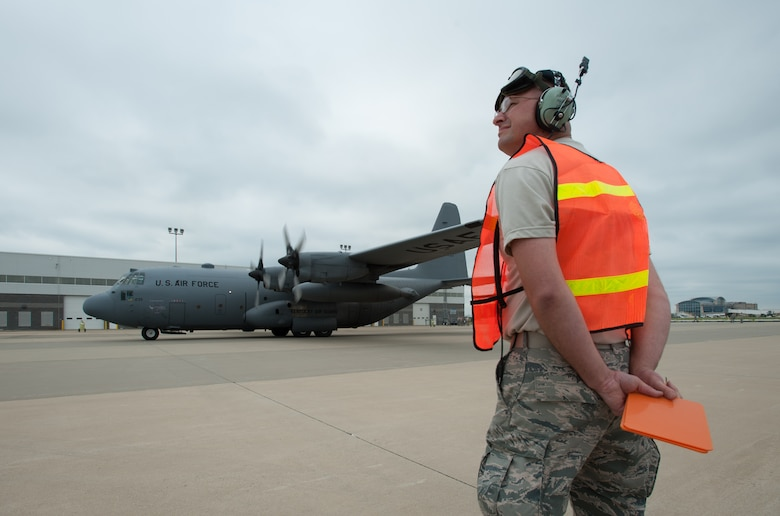 Master Sgt. James Nally, a flight chief for the Kentucky Air National Guard's 123rd Contingency Response Group, directs a C-130 to its parking spot at MidAmerica St. Louis Airport in Mascoutah, Ill., on Aug. 5, 2013, as part of Exercise Gateway Relief, a U.S. Transportation Command-directed earthquake-response scenario. The 123rd is joining forces with the U.S. Army's active-duty 689th Rapid Port Opening Element from Fort Eustis, Va., to stand up and operate a Joint Task Force-Port Opening, which combines an Air Force Aerial Port of Debarkation with an Army trucking and distribution unit. The aerial port ensures the smooth flow of cargo and relief supplies into affected areas by airlift, while the trucking unit facilitates their final distribution over land. (U.S. Air National Guard photo by Maj. Dale Greer)