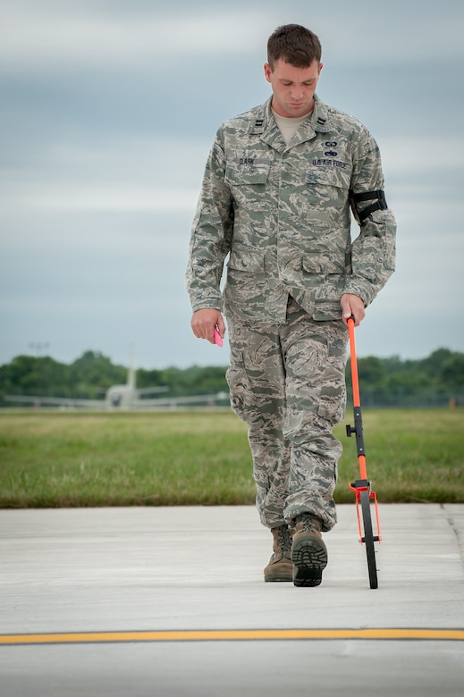Capt. Jeff Clark, an airfield management officer from the Kentucky Air National Guard's 123rd Contingency Response Group, measures the flight line to determine an aircraft parking plan at MidAmerica St. Louis Airport in Mascoutah, Ill., on Aug. 5, 2013, as part of Exercise Gateway Relief, a U.S. Transportation Command-directed earthquake-response scenario. The 123rd is joining forces with the U.S. Army's active-duty 689th Rapid Port Opening Element from Fort Eustis, Va., to stand up and operate a Joint Task Force-Port Opening, which combines an Air Force Aerial Port of Debarkation with an Army trucking and distribution unit. The aerial port ensures the smooth flow of cargo and relief supplies into affected areas by airlift, while the trucking unit facilitates their final distribution over land. (U.S. Air National Guard photo by Maj. Dale Greer)