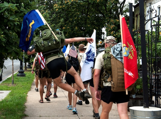 "Senior Airman Tommy Allgier of ""Delta Flight"" from the 13th Air Support Operations Squadron, clicks his heels half way in of the final leg of their journey to honor a fallen commander Maj. David Gray, Aug. 8, 2013. The ""DG"" 140 is a 140-mile memorial ruck march from the Casualty Reception Center at Dover AFB to Maj. Gray's headstone at Arlington National Cemetery in Virginia, Aug. 4-8. (U.S. Air Force photo/Senior Airman Carlin Leslie)"