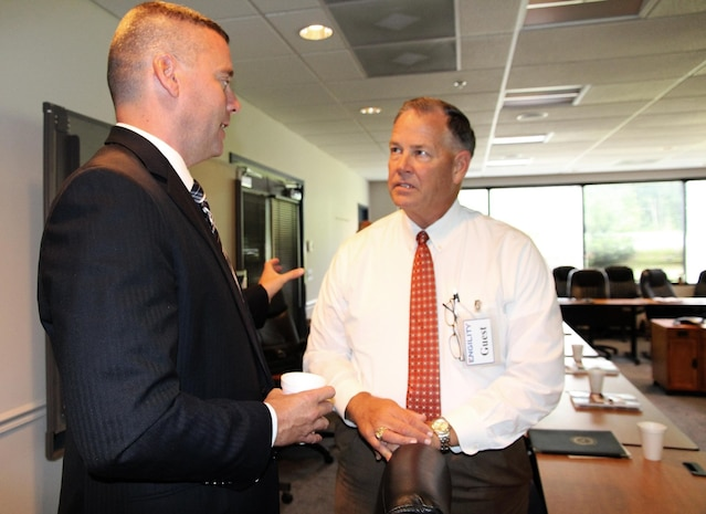 Michael Halloran, director of Science and Technology at Program Executive Officer Land Systems, speaks to Greg Jones, chief executive officer of Echelon Strategies, during the quarterly Industry Interface Council meeting Aug. 6 in Dumfries, Va. Marine Corps Systems Command hosted the event to discuss ways to improve communication between the command, PEO LS and industry partners.