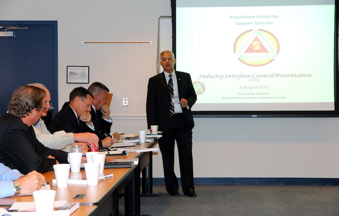Paul Ortiz, director of Marine Corps Systems Command's Acquisition Center for Support Services, speaks to industry attendees during the quarterly Industry Interface Council meeting Aug. 6 in Dumfries, Va. Marine Corps Systems Command hosted the event to discuss ways to improve communication between the command, PEO LS and industry partners.