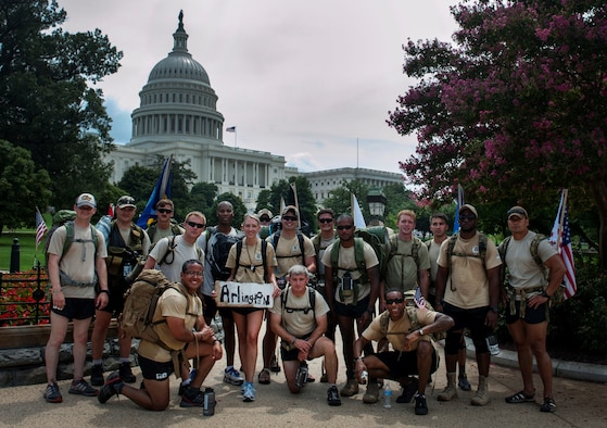 "The Airmen of ""Delta Flight"" from the 13th Air Support Operations Squadron pose for a group photo after reaching the capitol building in Washington, D.C., Aug 8, 2013. The ""DG"" 140 is a 140-mile memorial ruck march from the Casualty Reception Center at Dover Air Force Base, Del., to Maj. David Gray's headstone at Arlington National Cemetery, Aug 4-8. (U.S. Air Force photo/Senior Airman Carlin Leslie)"
