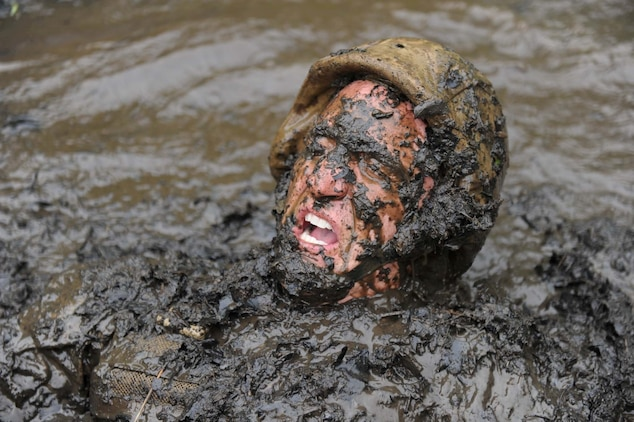 A sergeant instructor emerges from The Quigley, a series of water obstacles, during the Combat Course at Officer Candidates School on May 22, 2013. The OCS staff goes through the obstacles before each training cycle to reaquaint themselves with the different courses.