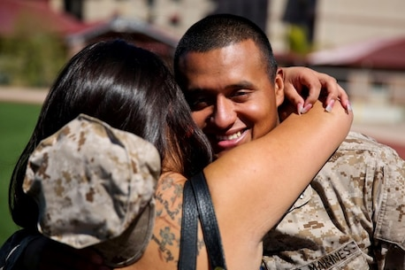 Sergeant Carlos Sanchez, engineer chief, Regimental Combat Team 7, and a native of Little Falls, N.J., embraces his wife Mercedes for the first time in nearly a year aboard Camp Margarita here, Aug. 7. The first main body of RCT-7 personnel returned to family and friends after being deployed approximately 10 months. The servicemembers worked with Afghan forces while deployed to Southwest Afghanistan.