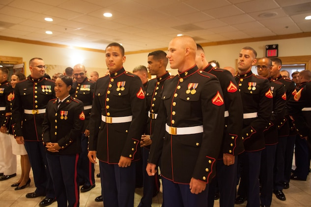 Marines with Marine Air Control Squadron 2 Detachment Alpha, prepare to march in the ball room of the Marine Corps Air Station Beaufort Officers' Club Prior to the beginning of their mess night, Aug. 1. Mess night is one of many Marine Corps traditions which allow the unit to come together and build camaraderie amongst one another.