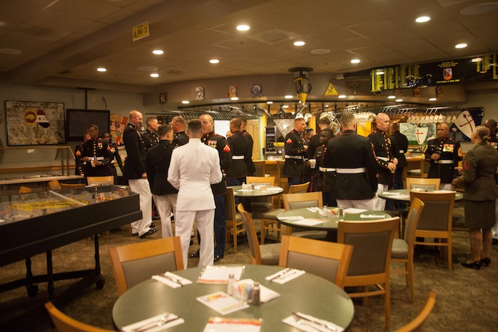 Marines with Marine Air Control Squadron 2 Detachment Alpha, gather for cocktail prior to their mess night at the bar of the Marine Corps Air Station Beaufort Officers' Club, Aug. 1. Mess night is one of many Marine Corps traditions which allow the unit to come together and build camaraderie amongst one another.