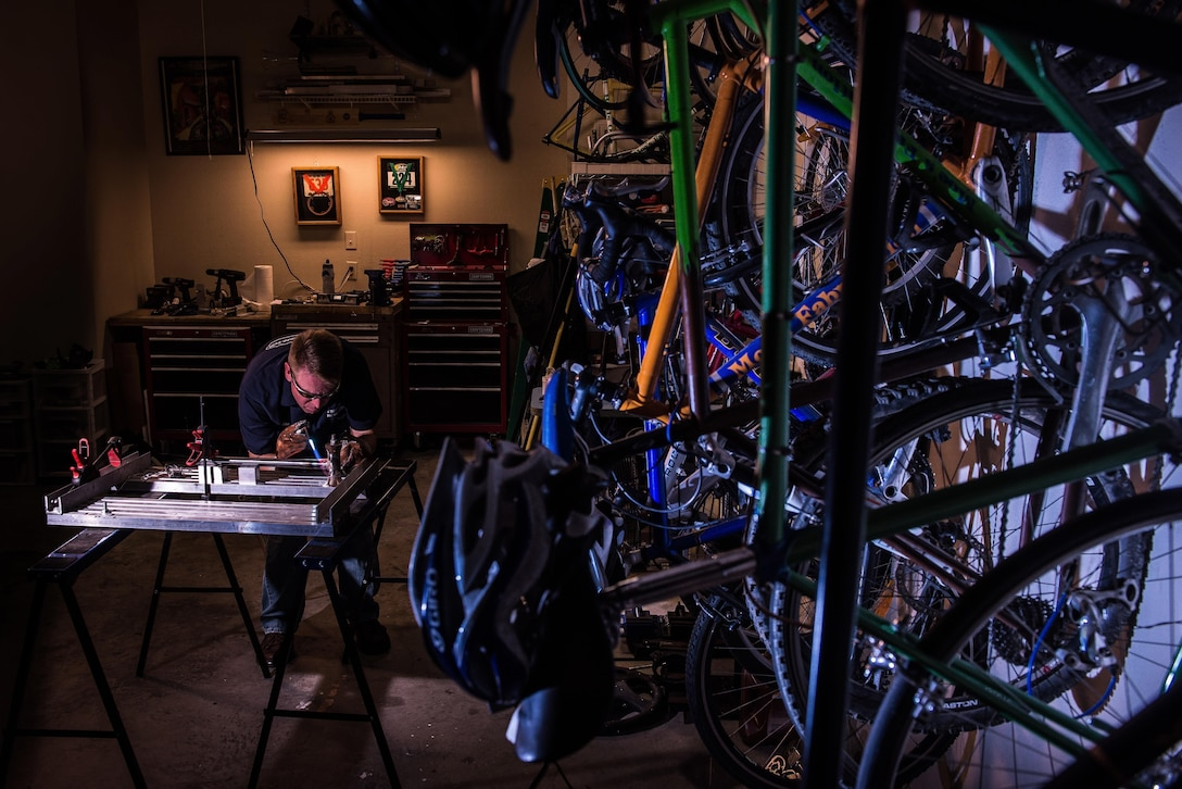 Senior Master Sgt. Maurice Milstead  works on a bicycle frame July 23, 2013, in Austin, Ark. Milstead builds custom bikes, including the $4,500 model that was destroyed in 2012 when a passing motorist sideswiped him. Milstead is the 19th Equipment Maintenance Squadron fabrication flight superintendent. (U.S. Air Force photo/Staff Sgt. Russ Scalf)