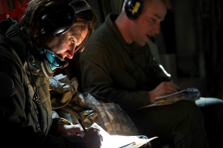 First Lt. Christi Nance  and Senior Airman Ulrich Deyoung document their patient's condition during an in-flight medical training scenario on a C-130 Hercules July 27, 2013. The training is part of Warrior Exercise 86-13-01 (WAREX)/Exercise Global Medic 2013. WAREX provides units an opportunity to rehearse military maneuvers and tactics. Held in conjunction with WAREX, Global Medic is an annual joint-field training exercise designed to replicate all aspects of theater combat medical support. Nance is a flight nurse and Deyoung is an aeromedical evacuation technician, both assigned to the 446th Aeromedical Evacuation Squadron at Joint Base Lewis-McChord, Wash. (U.S. Air Force photo/Tech. Sgt. Efren Lopez)