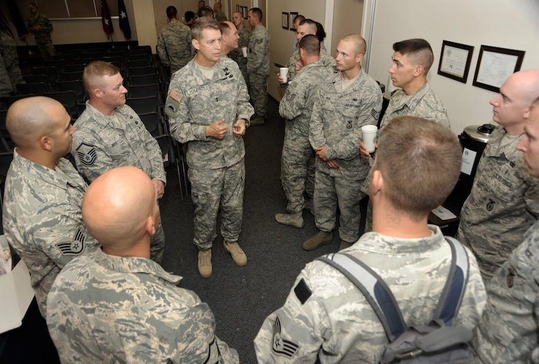 Oregon Adjutant General, Maj. Gen. Daniel Hokanson (center) takes time to talk with a group of Airmen from the 142nd Fighter Wing Security Forces Squadron during a USO event held at the Portland Air National Guard Base, Ore., Aug. 9, 2013. A total of 26 Airmen from the 142nd Fighter Wing spent six months in Qatar in support of Operation Enduring Freedom. (Air National Guard photo by Tech. Sgt. John Hughel, 142nd Fighter Wing Public Affairs/released)
