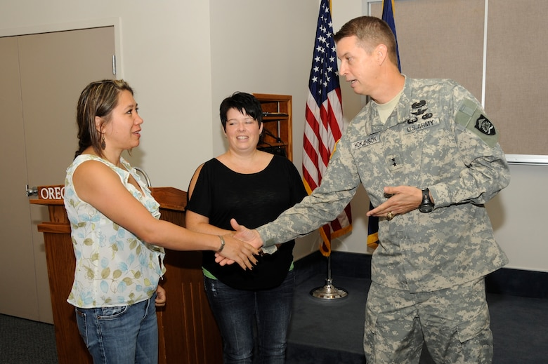 Maj. Gen. Daniel Hokanson, Oregon Adjutant General (right) thanks family support coordinators Tammy Davis (left) and Anndi Moore (center) for their volunteer efforts in support of the 142nd Fighter Wing Security Forces Squadron during their recent deployment after he addressed the group at the Portland Air National Guard Base, Ore., Aug. 9, 2013. (Air National Guard photo by Tech. Sgt. John Hughel, 142nd Fighter Wing Public Affairs/released)