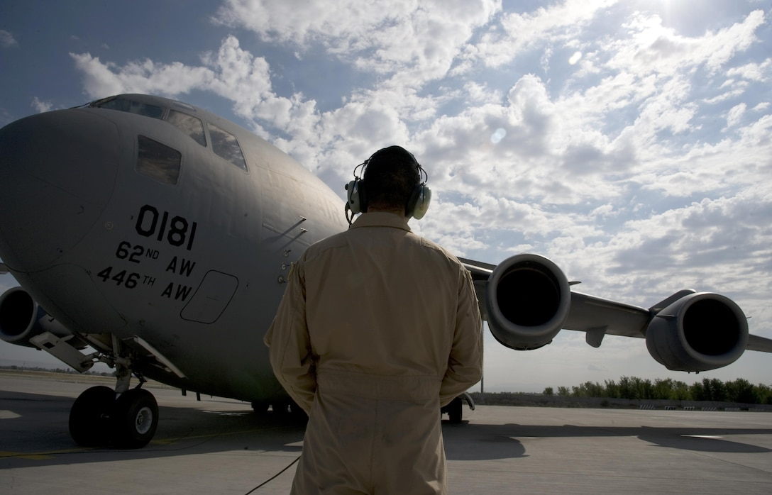 Senior Airman Justin Baez, 817th Expeditionary Airlift Squadron Detachment 1, loadmaster, observing the engine start of a C-17 Globemaster III  July 25, 2013, at Transit Center at Manas, Kyrgyzstan. Each member of the four-person aircrew has specific responsibilities that are carried out by following thorough checklists. A loadmaster observes engine start in order to alert the pilots and passengers in case of an emergency.