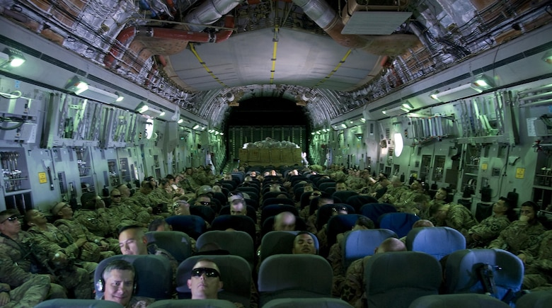 Service members are traveling to Transit Center at Manas, Kyrgyzstan on a C-17 Globemaster III, July 25, 2013. The service members and their gear were carried on the C-17 from Kandahar, Afghanistan.