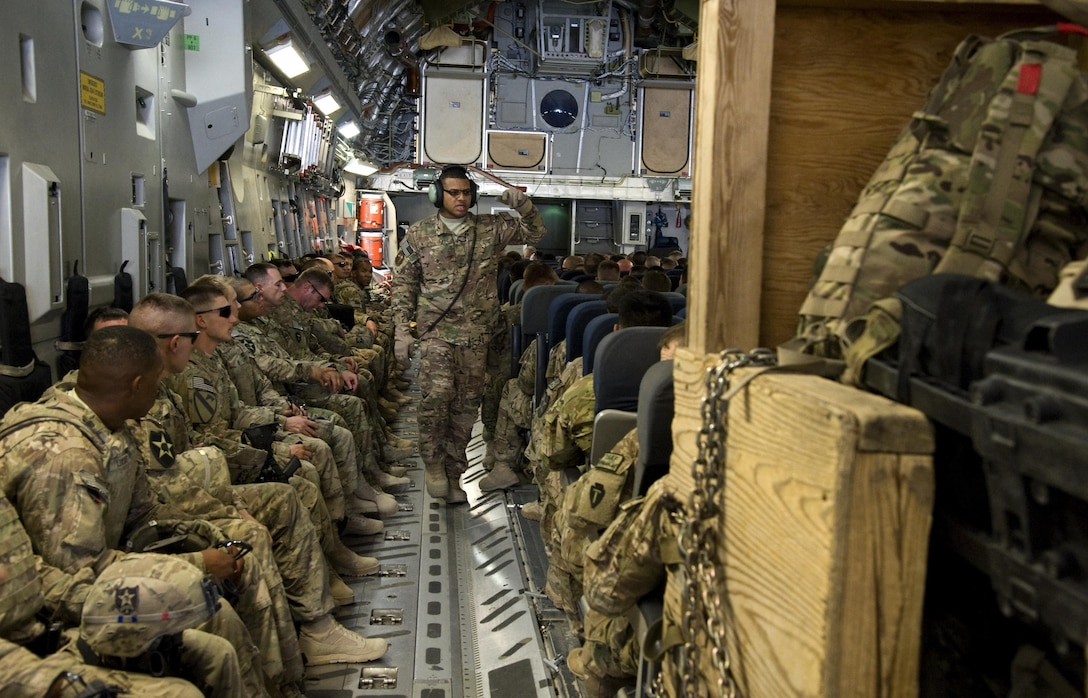 Tech. Sgt. Dequan Barthell, 817th Expeditionary Airlift Squadron Detachment 1, loadmaster evaluator, counts passengers on a C-17 Globemaster III July 25, 2013, prior to departure in Kandahar, Afghanistan. The flight carried 137 deployed service members to Transit Center at Manas, Kyrgyzstan.
