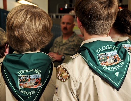 BIRMINGHAM, Ala. -- Boy Scouts, Troop 160, Oneonta, AL, listen to fire fighters at the 117th Air Refueling Wing in Birmingham, AL, here on Saturday. Fifteen Boy Scouts are earning their Aviation Merit Badge as a part of the visit to the 117th Air Refueling Wing. (U.S. Air National Guard photo by A1C Wesley A. Jones/Released)