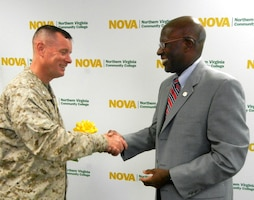 Col. David W. Maxwell, Marine Corps Base Quantico commander, shakes hands and thanks, Sam Hill, Northern Virginia Community College provost, July 29, 2013, for NOVA's efforts to reach the military academic community at the Voluntary Education Center of aboard Marine Corps Base Quantico. NOVA revamped their business administration and information systems technology program, making the them shorter.