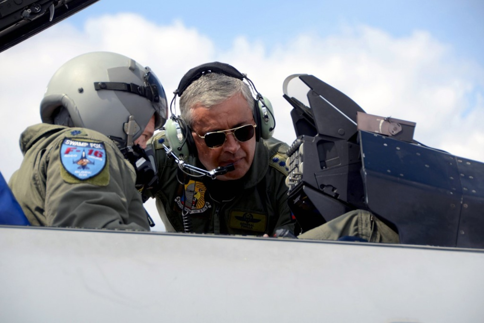 Gen. Tito Saul Pinilla Pinilla, commander of the Colombian Air Force, speaks with Lt. Col. Scott Bridgers, 169th Aircraft Maintenance Squadron commander and F-16 fighter pilot, during his tour of McEntire Joint National Guard Base, S.C., April 8, 2013.